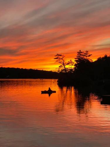 fiery sunset with fisherman