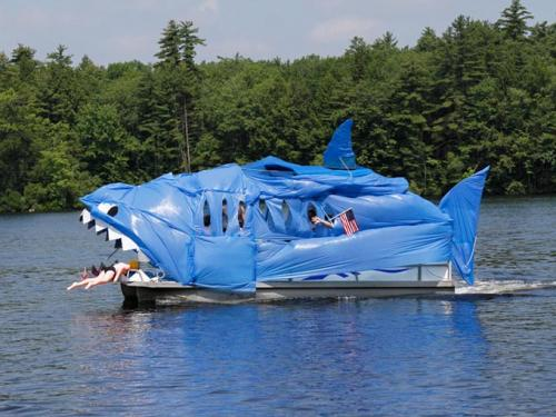 A pontoon boat decorated as a shark.